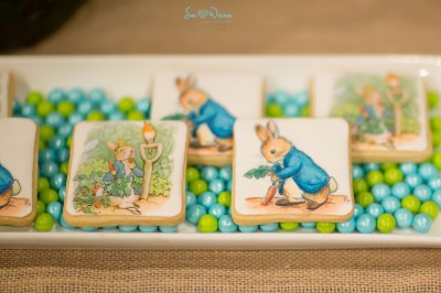 Peter Rabbit Baby Shower Dessert Table with themed sweets | #desserttables #backdrop #cakepops | www.cwdistinctivedesigns.com